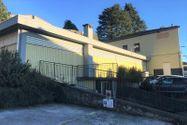 Immagine n0 - Negozio con due appartamenti e parcheggio - Asta 10370