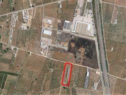 Terreno edificabile con fabbricato industriale in costruzione - Lotto 10561 (Asta 10561)