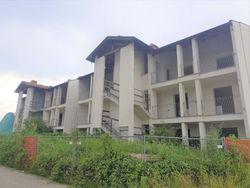 Tredici appartamenti con garage allo stato grezzo