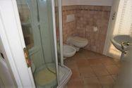 Immagine n3 - Appartamento con giardino, cantine e garage - Asta 11042
