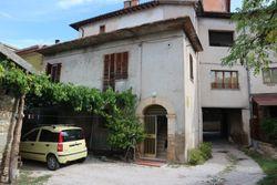 Porzione di edificio con abitazioni, annesso accessorio e terreno - Lotto 11108 (Asta 11108)