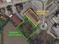 Terreno edificabile commerciale e posti auto interrati - Lotto 12256 (Asta 12256)