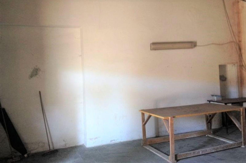 #2031 Negozio grezzo (subalterno 63) al piano terra in vendita - foto 2