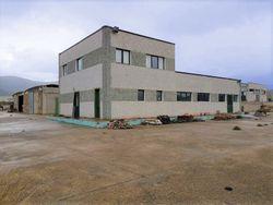 Opificio con abitazione custode e volume edificabile