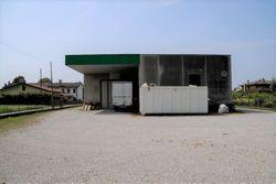 Capannone, magazzino e quattro appartamenti - Lotto 62 (Asta 62)