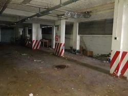 Posto auto coperto in edificio condominiale (Sub 517) - Lotto 7163 (Asta 7163)