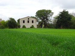 Casa colonica con terreni agricoli