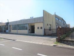 Porzione di fabbricato commerciale con annessa area scoperta