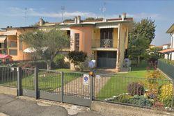 Villetta a schiera con autorimessa e giardino
