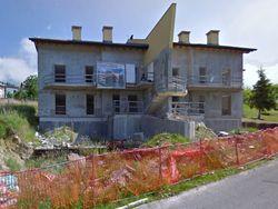 Terreno edificabile con edificio residenziale in costruzione - Lotto 8948 (Asta 8948)