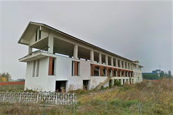 Terreno edificabile con edifici in costruzione