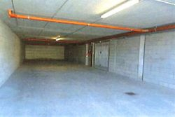 Three car garage in the basement of the condominium - Lot 9822 (Auction 9822)